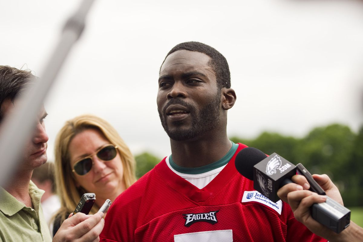 May 22, 2012; Philadelphia, PA, USA; Philadelphia Eagles quarterback Michael Vick (7) is interviewed after practice during organized team activities at the Philadelphia Eagles NovaCare Complex. Mandatory Credit: Howard Smith-US PRESSWIRE
