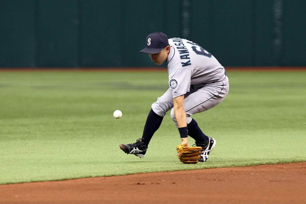 May 3, 2012; St. Petersburg, FL, USA; Seattle Mariners shortstop Munenori Kawasaki (61) misses a line drive in the second inning against the Tampa Bay Rays at Tropicana Field. Mandatory Credit: Kim Klement-US PRESSWIRE