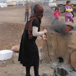LDS Charities — the humanitarian arm of The Church of Jesus Christ of Latter-day Saints —is partnering with other organizations to help those impacted by the crisis in the Middle East. Recipients of the aid include internally displaced people living in the Bajed Kandala 1 and 2 camps in northern Iraq, such as this woman baking naan bread in a tandoor or traditional clay oven.