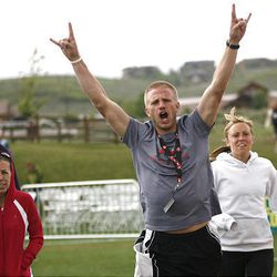 Bennett Norton, 28, of Bluffdale, raises his arms as he and members of the team 200 More Yards approach the finish line of the Ragnar Relay Wasatch Back race in Park City on Saturday.