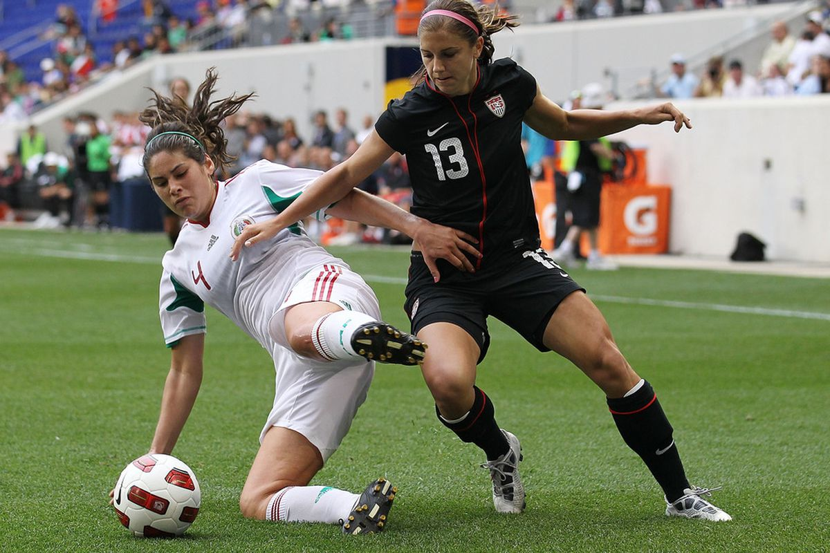 HARRISON, NJ - JUNE 05: Alex Morgan #13 of the United States challenges Alina Garciamendez #4 of Mexico during their International Friendly at Red Bull Arena on June 5, 2011 in Harrison, New Jersey.  (Photo by Nick Laham/Getty Images)