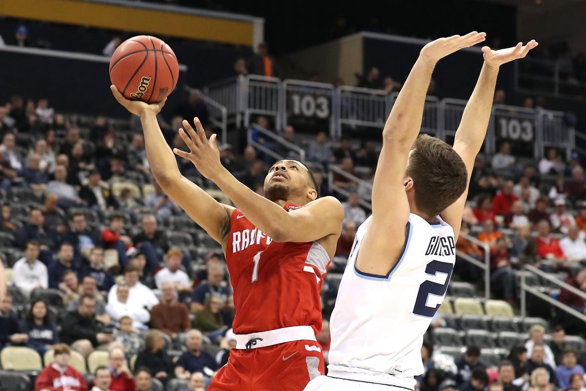 Carlik Jones of the Radford Highlanders shoots the ball against Collin Gillespie of the Villanova Wildcats during the first half of the game in the first round of the 2018 NCAA Men's Basketball Tournament at PPG PAINTS Arena on March 15, 2018 in Pittsburgh, Pennsylvania.
