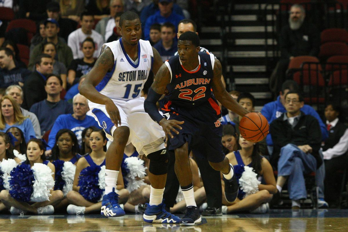 NEWARK, NJ - DECEMBER 02:  Kenny Gabriel #22 of the Auburn Tigers drives against Herb Pope #15 of the Seton Hall Pirates at Prudential Center on December 2, 2011 in Newark, New Jersey.  (Photo by Chris Chambers/Getty Images)