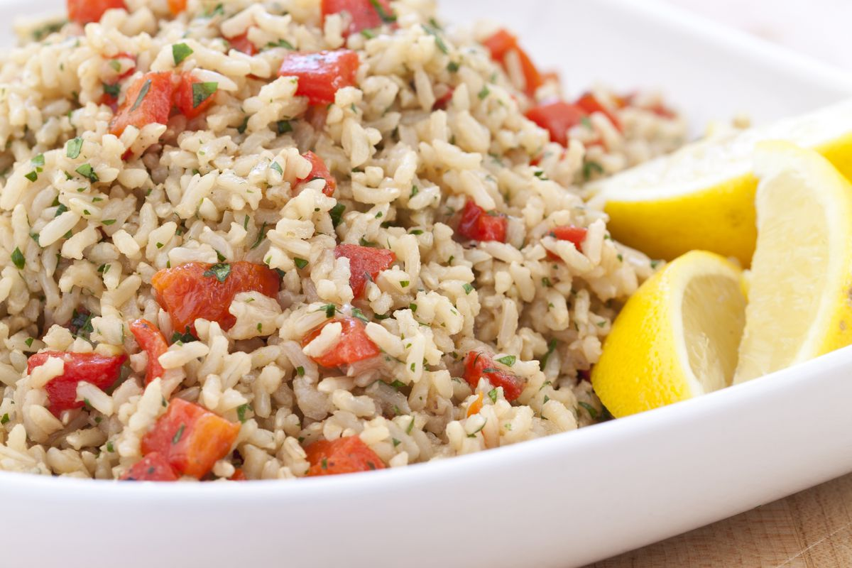 Baked brown rice with roasted red peppers and onions is a delicious vegan dish for lunch or dinner.