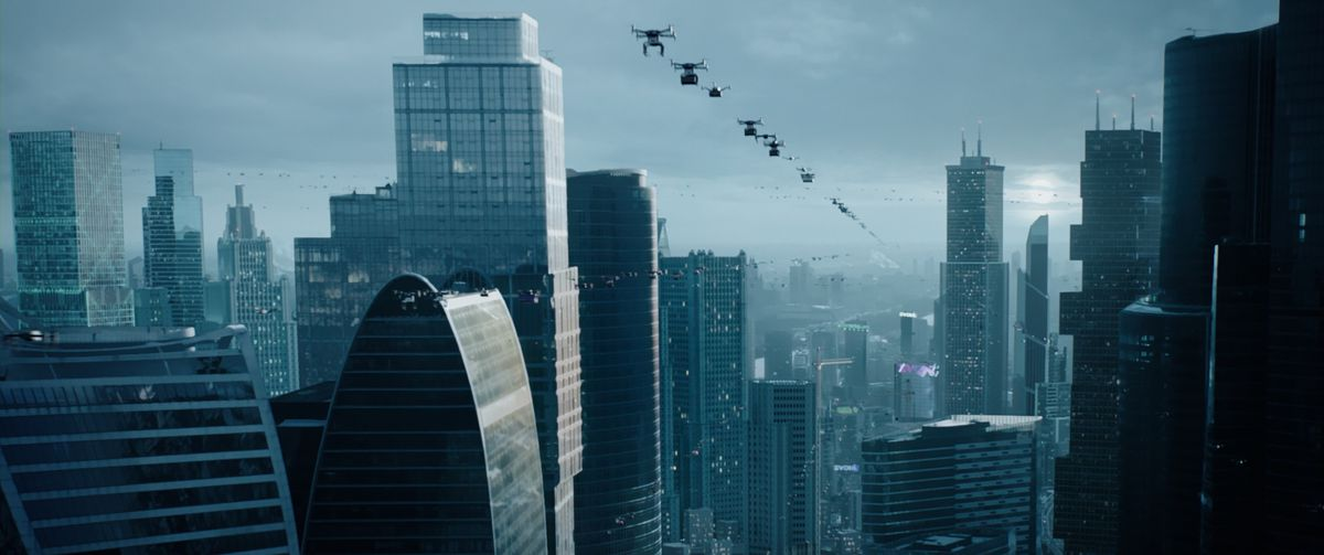 A line of drone-like vehicles stretches over a futuristic blue city.