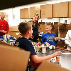 The Petersen and Crane families volunteer together at the Utah Food Bank several times a year.