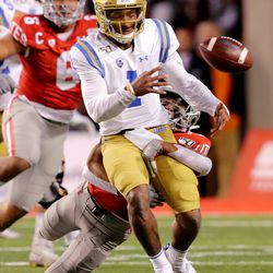 UCLA Bruins quarterback Dorian Thompson-Robinson (1) loses the ball as he is hit by Utah Utes defensive back Julian Blackmon (23) as Utah and UCLA play a college football game in Salt Lake City at Rice-Eccles Stadium on Saturday, Nov. 16, 2019.