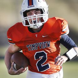 Timpview's Britain Covey sprints around the corner as Timpview and Sky View play in the second round of the state football playoffs Friday, Nov. 8, 2013. Timpview won 49-17.