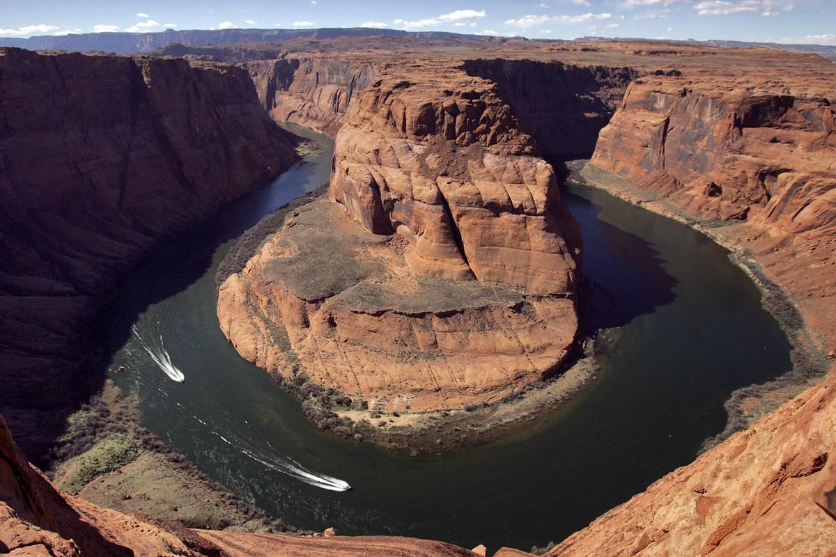 In this Wednesday, March 5, 2008, file photo, water levels at the Colorado River's Horseshoe Bend begin to rise along the beaches just hours after the Glen Canyon Dam jet tubes began releasing water, in Page, Ariz. Drought, climate change and an increasin