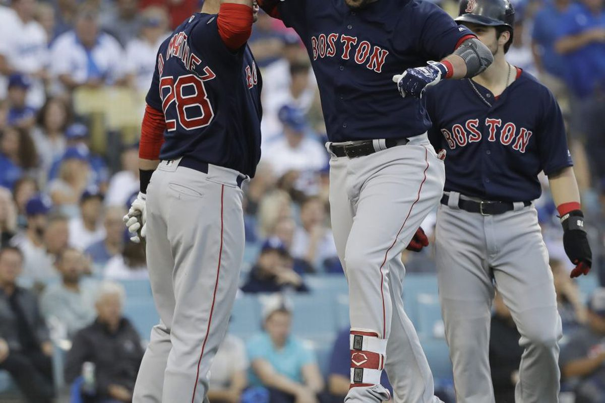 6945a9fe3 Boston Red Sox's Steve Pearce celebrates with J.D. Martinez (28) and Andrew  Benintendi after hitting a two-run home run during the first inning in Game  5 of ...