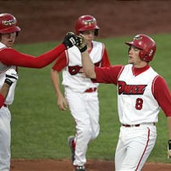Orem's Mark Trumbo congratulates Flint Wipke, right, after he hits a two-run homer in the playoffs.
