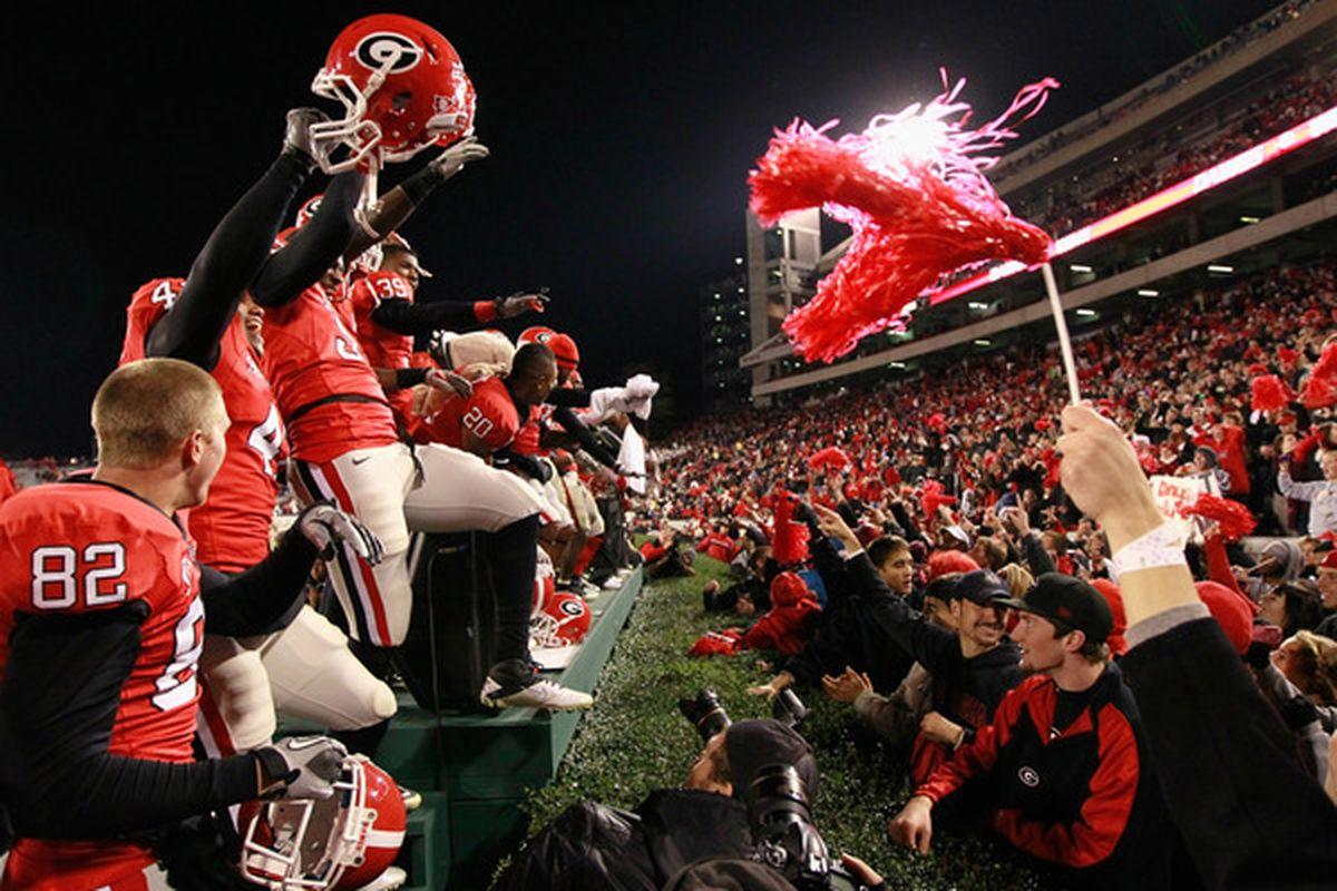 ATHENS GA - NOVEMBER 27:  The Georgia Bulldogs celebrate their 42-34 win over the Georgia Tech Yellow Jackets at Sanford Stadium on November 27 2010 in Athens Georgia.  (Photo by Kevin C. Cox/Getty Images)