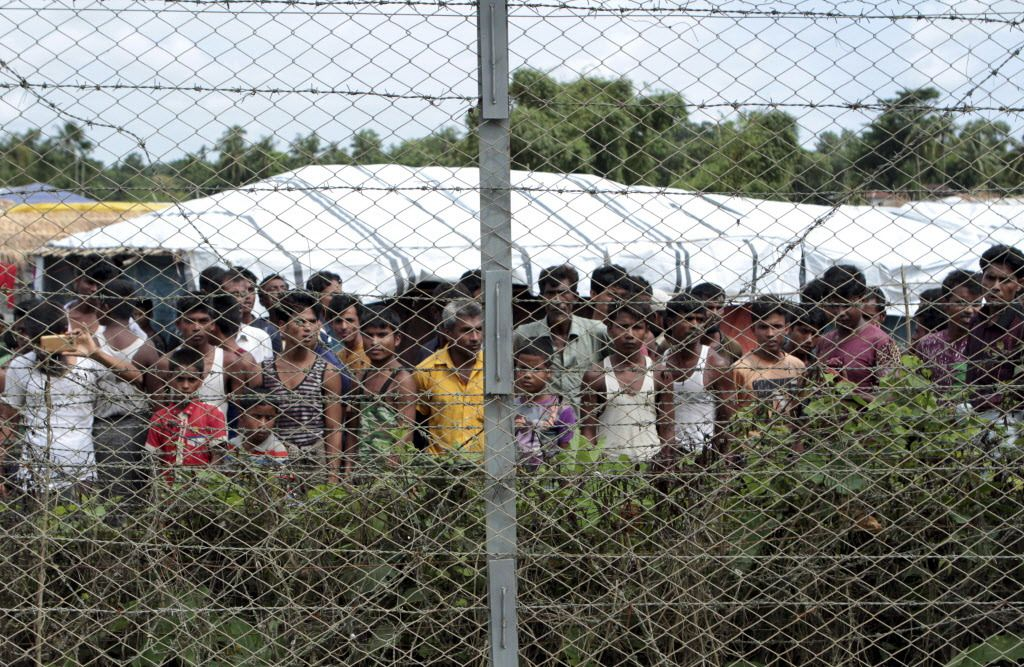 Rohingya refugees gather during a government-organized media tour in late June of a no-man's land between Myanmar and Bangladesh in northern Rakhine State where thousands of Rohingya Muslims are still living.   AP