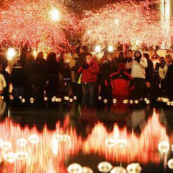 Hundreds of visitors wander and enjoy Christmas lights on the reflecting pond in November of this year.