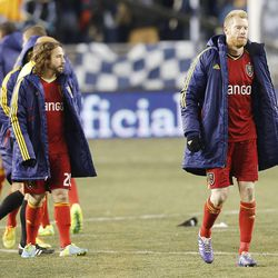 Real's Ned Grabavoy and Nat Borchers walk off the pitch after Real lost to Sporting KC Saturday, Dec. 7, 2013 in MLS Cup action.