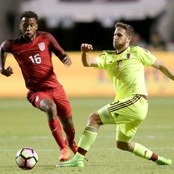 United States' Kellyn Acosta (16) and Venezuela's Francisco La Mantia (13) fight for the ball during a soccer game at Rio Tinto Stadium in Sandy on Saturday, June 3, 2017. They tied 1-1.