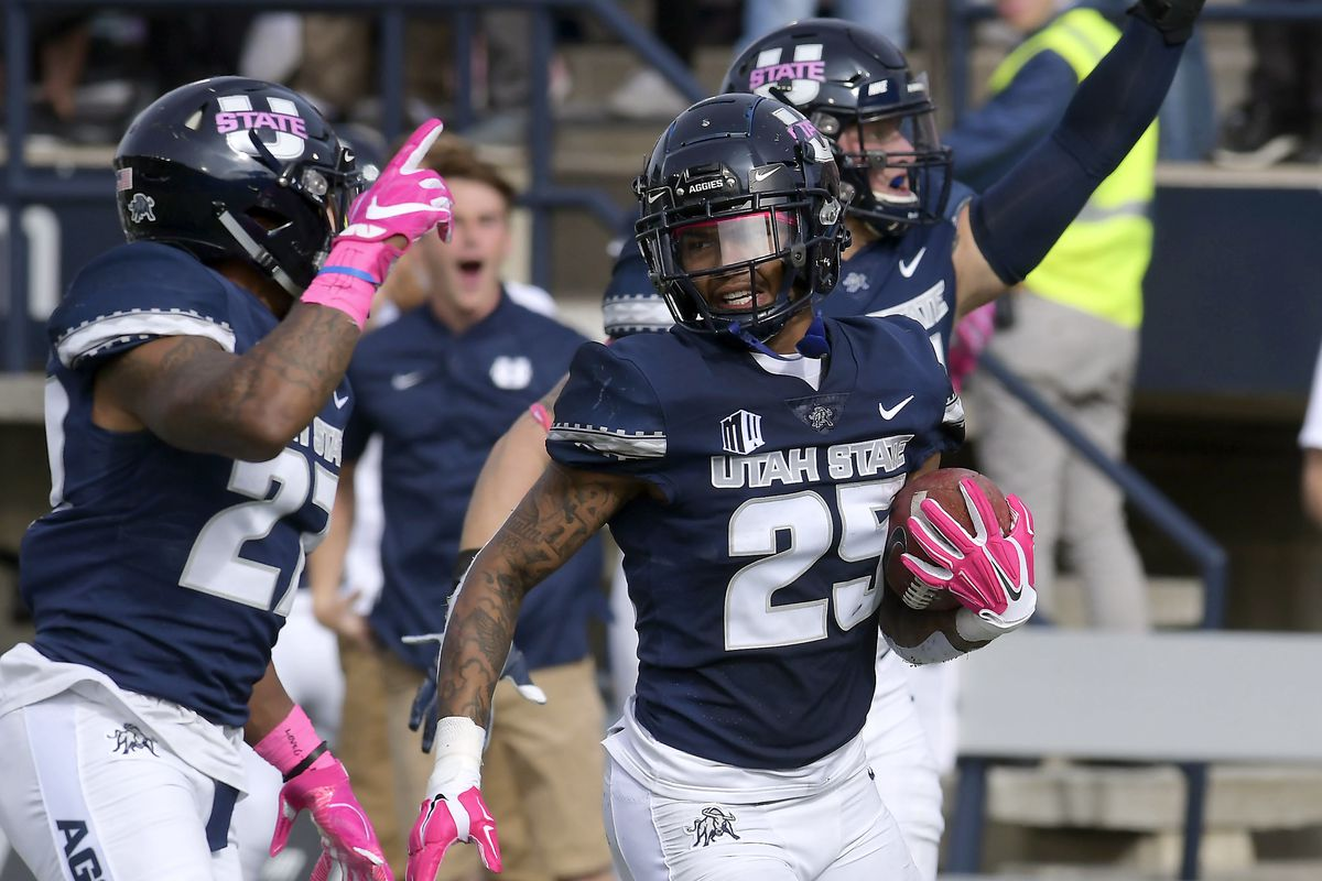 Utah State safety Shaquez Bond (25) returns an interception 100 yards for a touchdown against New Mexico during an NCAA college football game, Saturday, Oct. 27, 2018, in Logan, Utah. (Eli Lucero/The Herald Journal via AP)
