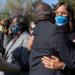 The Rev. France Davis, a member of Salt Lake City's Commission on Racial Equity in Policing, embraces Mayor Erin Mendenhall after a press conference at the International Peace Gardens in Salt Lake City on Tuesday, April 20, 2021. The group gathered to share their reaction to the guilty verdicts returned in the trial of former police officer Derek Chauvin in Minneapolis.
