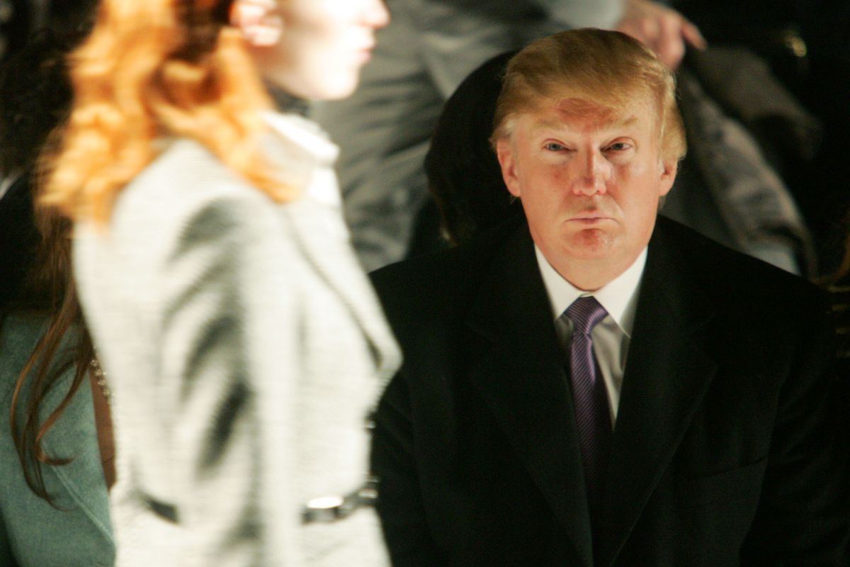 Trump with model walking past