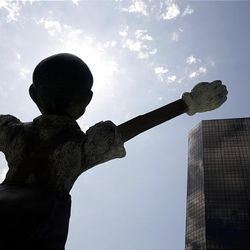 """A statue called """"Big White Gloves, Big Four Wheels"""" by Jim Dine is seen during the unveiling of St. Louis' Citygarden."""