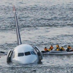 FILE - In this Jan. 15, 2009 file photo, passengers in an inflatable raft move away from an Airbus 320 US Airways aircraft that has gone down in the Hudson River in New York. The day after geese hit a second airliner and forced it to make an emergency landing at a New York airport, U.S. Sen. Kirsten Gillibrand, D-NY, introduced legislation Wednesday, April 25, 2012 that would make it easier to round up geese near JFK Airport and kill them.