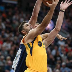 Utah Jazz guard Raul Neto (25) lays it up ahead of Denver Nuggets center Mason Plumlee (24) at Vivint Smart Home Arena in Salt Lake City on Tuesday, Nov. 28, 2017.