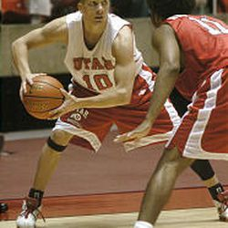Utah's Casey Iverson, left, is defended by Tim Drisdom in a scrimmage game during the annual Night with the Runnin' Utes.