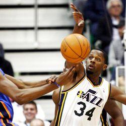 Utah Jazz forward C.J. Miles (34) knocks the ball away from Oklahoma's #35 Kevin Durant as the Utah Jazz play the Oklahoma City Thunder Tuesday, March 20, 2012 in Salt lake City.