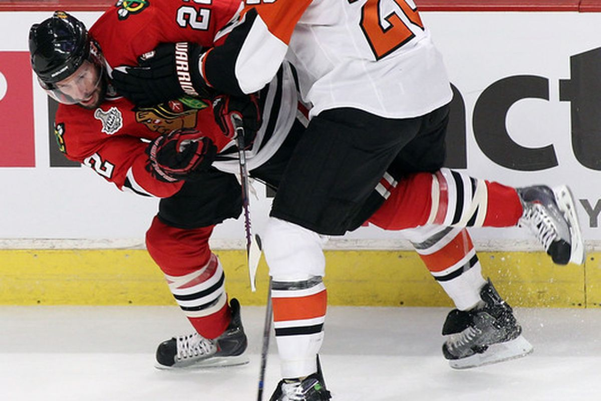 Blackhawk fans are greatly concerned as they watch Chris Pronger go for the Mandible Claw on Troy Brouwer.