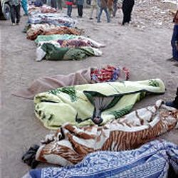 Bodies are covered by blankets in the aftermath of the Dec. 26, 2003, earthquake that struck Bam, Iran. More than 5,000 died, and 30,000 were injured.