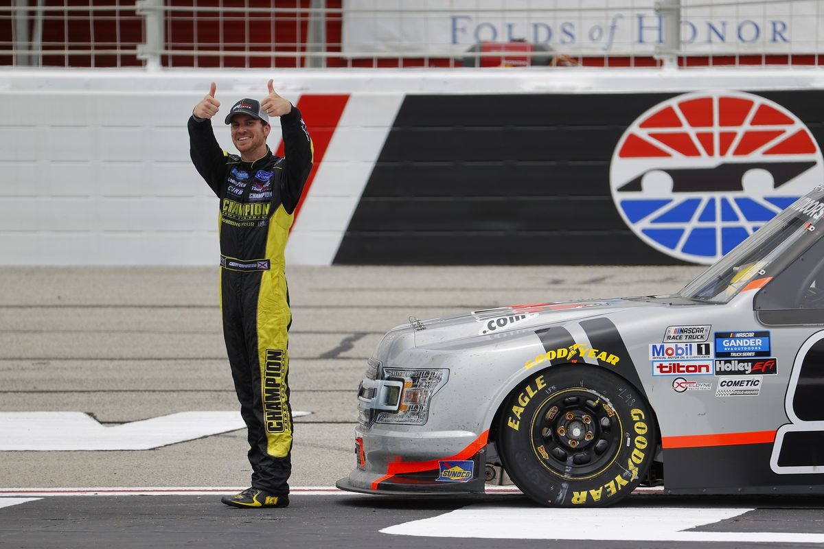 Grant Enfinger, driver of the #98 Farm Paint Ford, celebrates after winning the NASCAR Gander Outdoors Truck Series Vet Tix Camping World 200 at Atlanta Motor Speedway on June 06, 2020 in Hampton, Georgia.