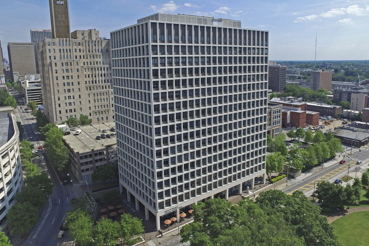 A 19-story office tower in downtown Atlanta has trees and a park at its base.