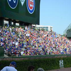 2:59 p.m. Neon caps in the left field bleachers -