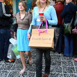 Courtney Love and daughter Frances Bean during a Robertson shopping stroll that involved Kitson, Curve, and the now-shuttered Nanette Lepore boutique.