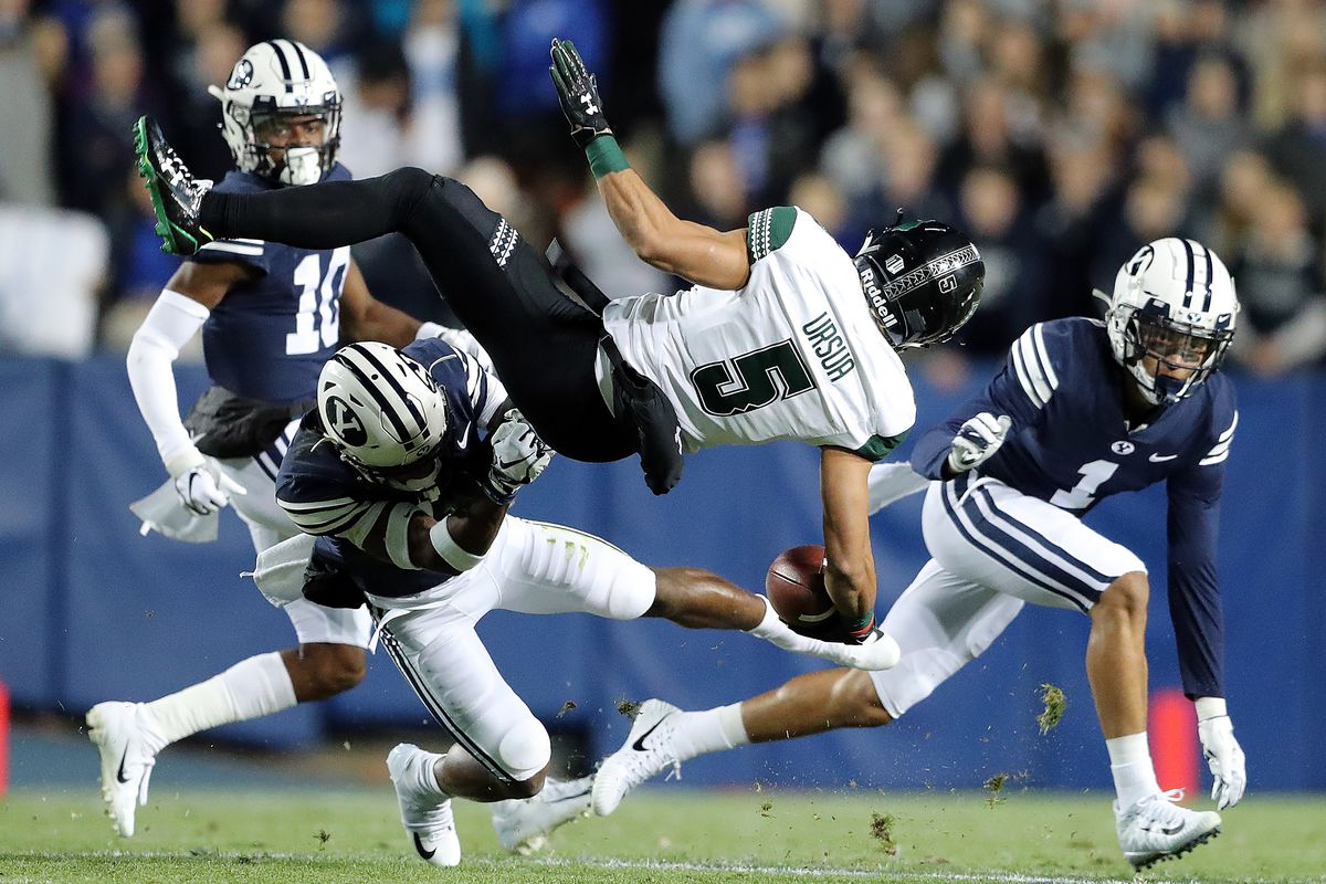 Brigham Young Cougars defensive back Michael Shelton (18) brings Hawaii Warriors wide receiver John Ursua (5) down after a catch and run as BYU and Hawaii play at LaVell Edwards Stadium in Provo on Saturday, Oct. 13, 2018.