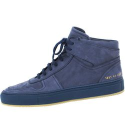 """<strong>Common Projects</strong> BBall High in Nubuck Navy, <a href=""""https://www.odinnewyork.com/search.asp?Mode=Product&Type=Shop&TypeID=37&ProductID=3423#"""">$545</a> at Odin"""