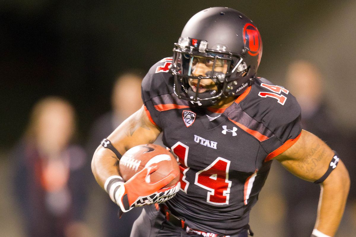 October 27, 2012; Salt Lake City, UT, USA; Utah Utes wide receiver Reggie Dunn (14) returns a kickoff for a touchdown during the first quarter against the California Golden Bears at Rice-Eccles Stadium.