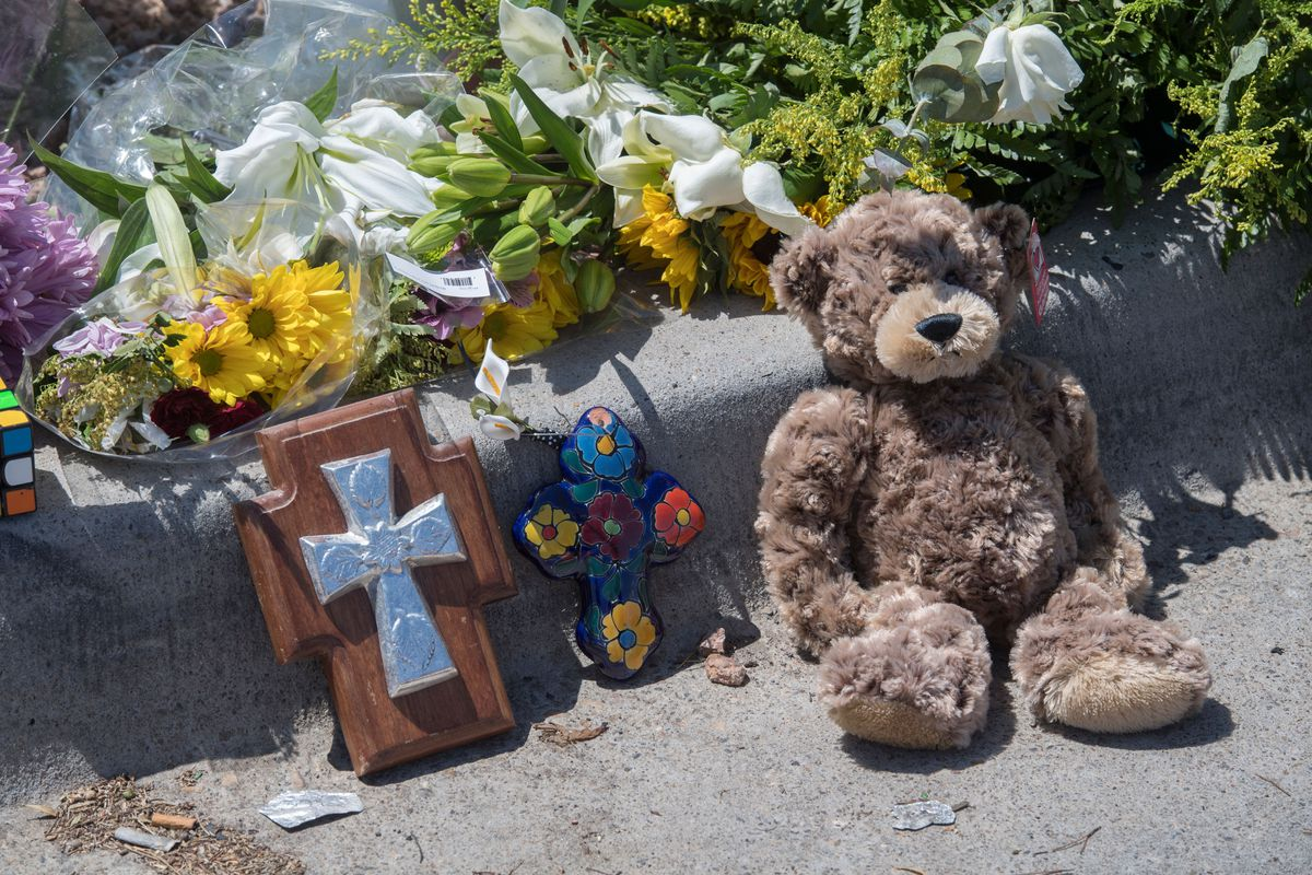 A makeshift memorial with flowers and a teddy bear near the Walmart in El Paso, Texas, near the site of a shooting.
