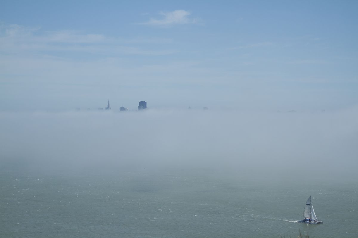 Just the top of a few buildings visible through the San Francisco fog.