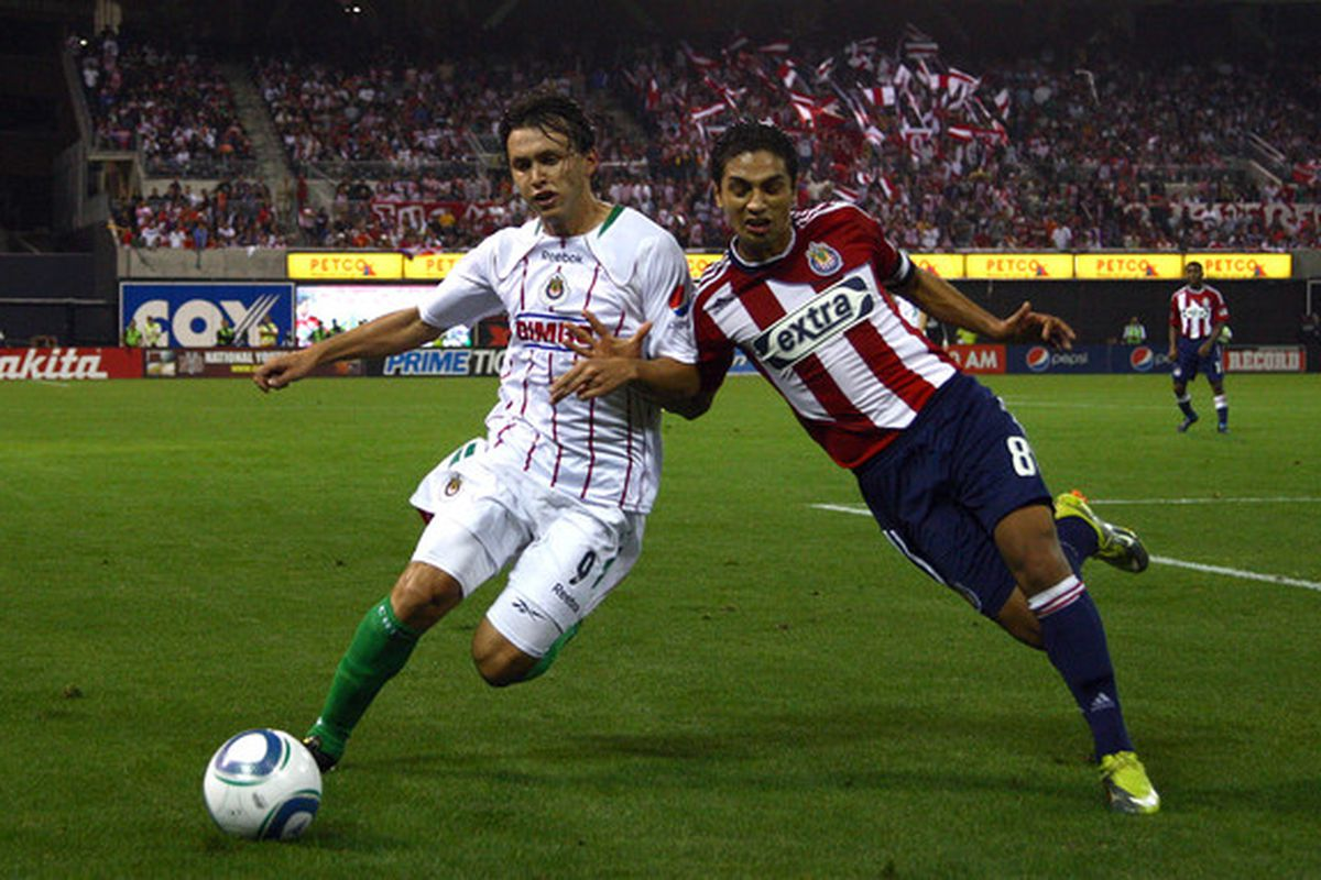 SAN DIEGO CA - SEPTEMBER 14:  Mariano Trujillo #8 of Chivas USA  and Omar Arellano #9 of Chivas Guadalajara play in their ChivasClásico soccer match on September 14 2010 at PETCO Park in San Diego California. (Photo by Donald Miralle/Getty Images)