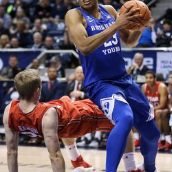 Brigham Young Cougars forward Yoeli Childs (23) spins around Utah Utes forward Tyler Rawson (21) at the Marriott Center in Provo on Saturday, Dec. 16, 2017.