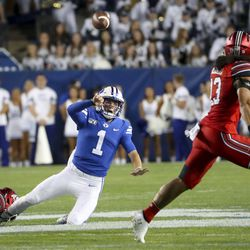 Brigham Young Cougers quarterback Zach Wilson (1) pulls down as he tries to throw a pass that was cut by Utah Utes backhand Francis Bernard who returned him for a break during the University of Utah's BYU football game at LaVell Edwards Provo Stadium on Thursday, August 29, 2019.
