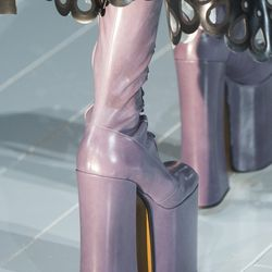 These would only trigger acrophobia, the fear of heights, if the sufferer was made to wear them, which: cruel.