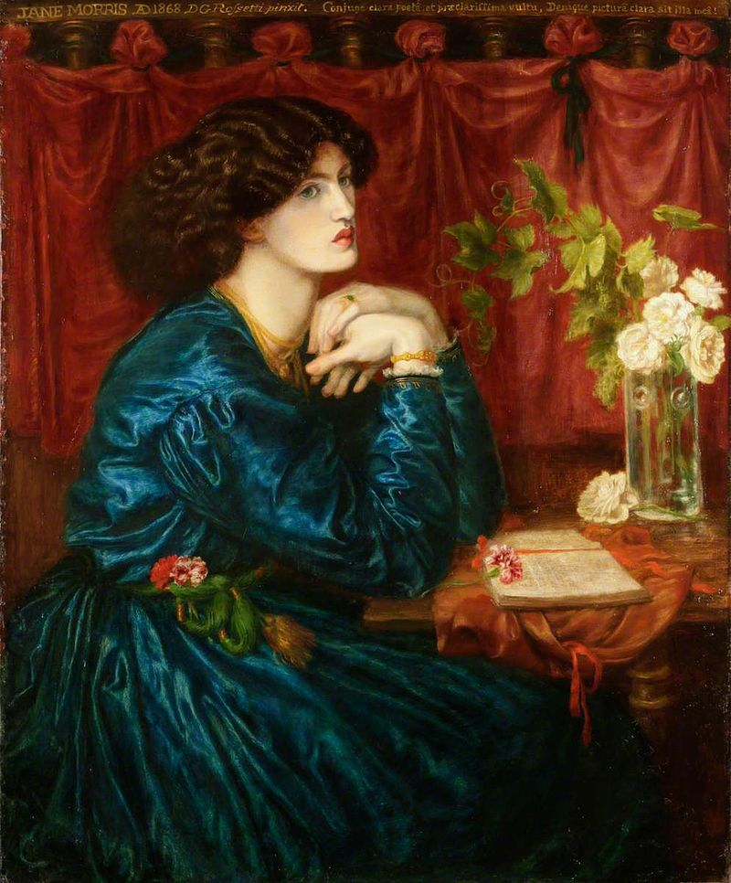 Woman in the 1800s in a blue silk dress, seated looking wistful.