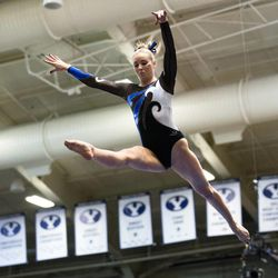 Former BYU gymnast Summer Raymond, seen here on the balance beam in a 2014 meet, is engaged to former BYU basketball star Tyler Haws.