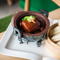 Mao Style Braised Pork in Clay Pot: Pork Belly, Chinese Chestnut, Red Bean Curd Sauce, served with Bao ($18).