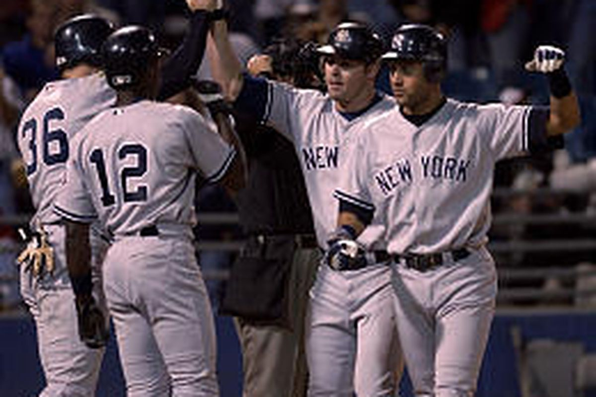 Yankees' Jason Giambi, second from right, is congratulated after hitting a grand slam in the ninth.