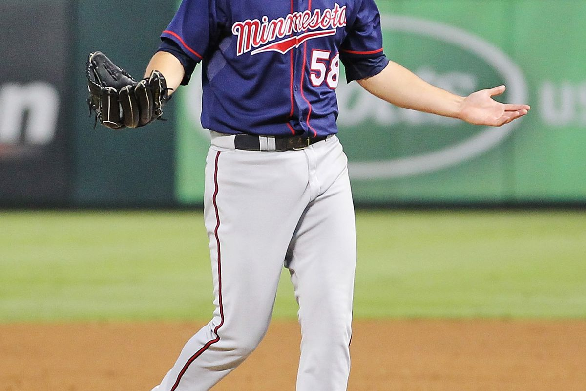 Aug 23, 2012; Arlington, TX, USA; Minnesota Twins starting pitcher Scott Diamond (58) reacts after being thrown out of the game during the third inning against the Texas Rangers at Rangers Ballpark.  Mandatory Credit: Kevin Jairaj-US PRESSWIRE