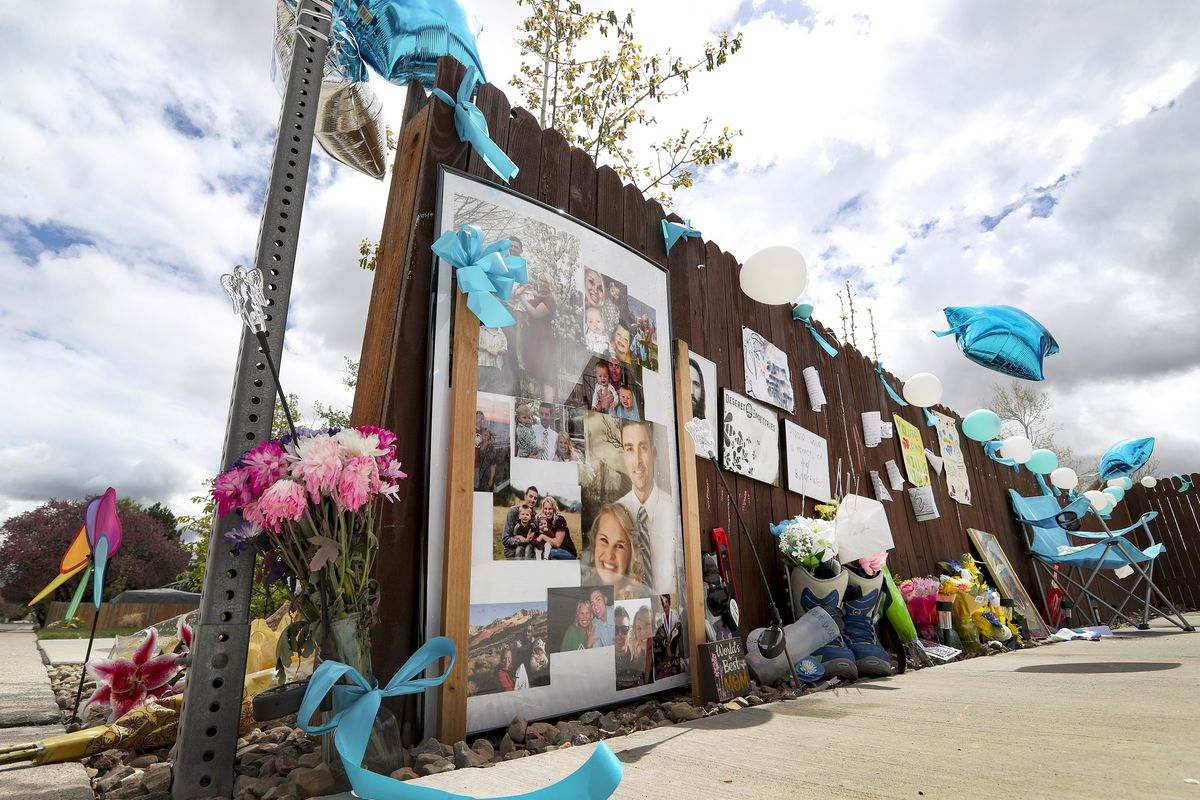 A memorial outside of the West Jordan home of Tony and Katherine Butterfield is pictured on Thursday, April 23, 2020. Albert Enoch Johnson was arrested Wednesday in Stockton, California, in connection with the Butterfields' shooting deaths.