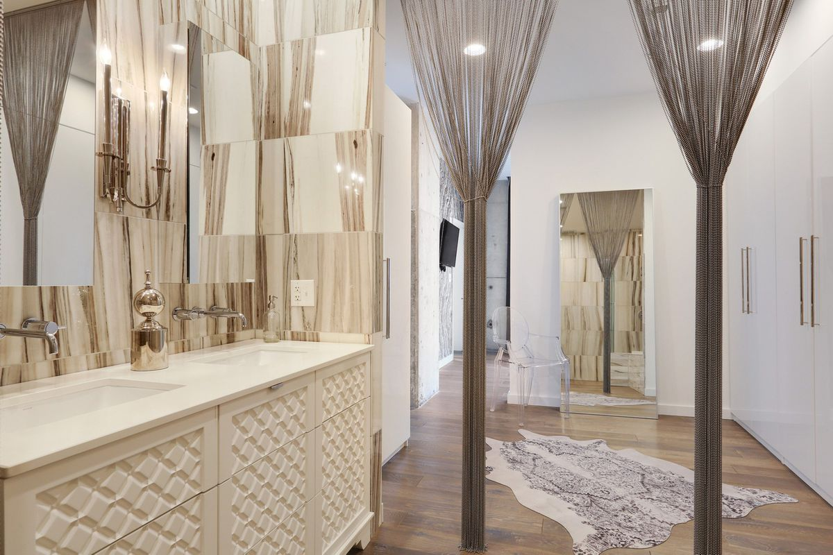 A large master bathroom done in white.
